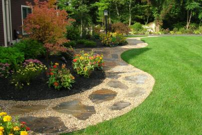 Gravel walkway with flagstone inlay